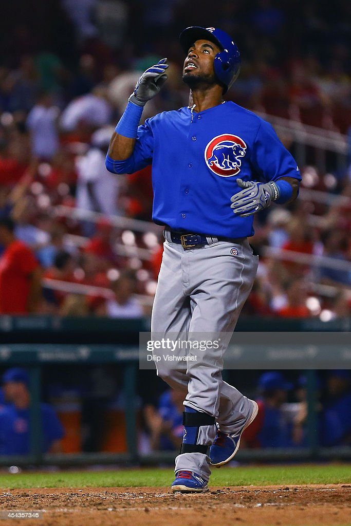 Arismendy Alcantara #7 of the Chicago Cubs crosses home plate after hitting a solo home run against the St. Louis Cardinals in the ninth inning at Busch Stadium on August 29, 2014 in St. Louis, Missouri. The Cubs beat the Cardinals 7-2.