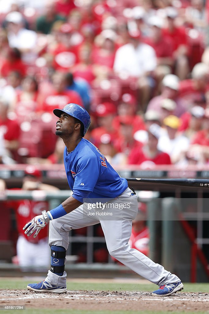 Arismendy Alcantara #7 of the Chicago Cubs drives in a run with a sacrifice fly in the third inning of the game against the Cincinnati Reds at Great American Ball Park on July 10, 2014 in Cincinnati, Ohio.