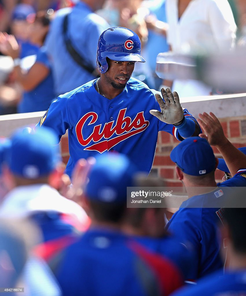 Arismendy Alcantara #7 of the Chicago Cubs is greeted by teammates in the dugout after hitting a solo home run in the 5th inning against the Baltimore Orioles at Wrigley Field on August 24, 2014 in Chicago, Illinois.