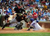Arismendy Alcantara of the Chicago Cubs slides safely as Russell Martin of the Pittsburgh Pirates make a tag during the third inning on September 5...