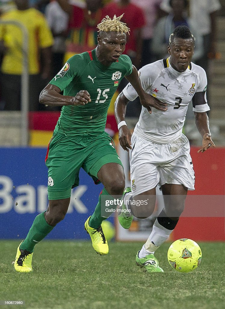 AFRICA - FEBRUARY 06, Aristide Bance from Burkina Faso (L) and Asamoah Gyan (Captain) from Ghana (R) during the 2013 Orange African Cup of Nations 2nd Semi Final match between Burkina Faso and Ghana at Mbombela Stadium on February 06, 2013 in Nelspruit, South Africa.