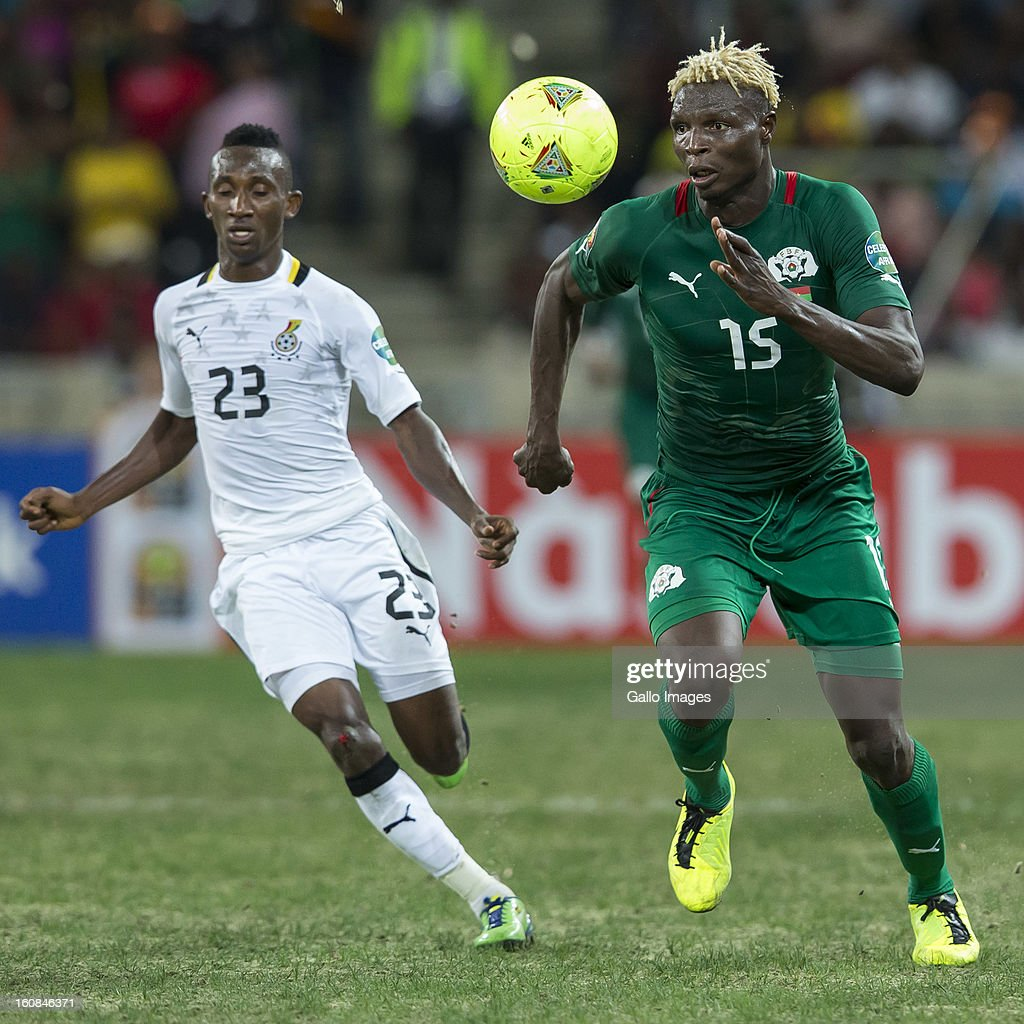 Aristide Bance from Burkina Faso (R) and Harrison Afful from Ghana compete for the ball during the 2013 Orange African Cup of Nations 2nd Semi Final match between Burkina Faso and Ghana at Mbombela Stadium on February 06, 2013 in Nelspruit, South Africa.