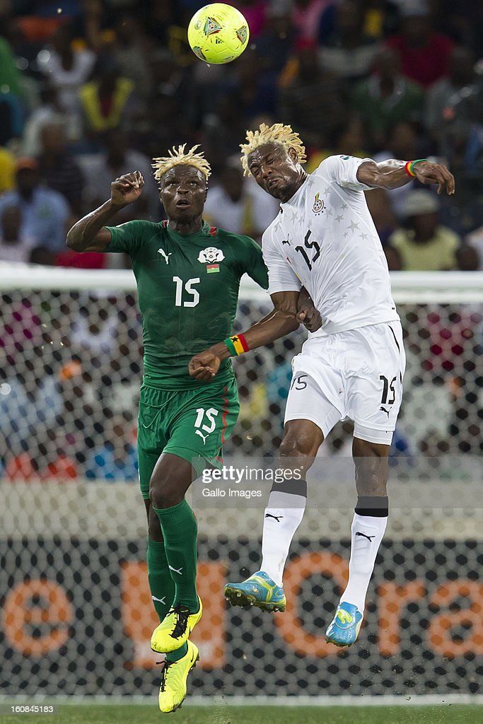 <a gi-track='captionPersonalityLinkClicked' href=/galleries/search?phrase=Aristide+Bance&family=editorial&specificpeople=3123631 ng-click='$event.stopPropagation()'>Aristide Bance</a> from Burkina Faso and <a gi-track='captionPersonalityLinkClicked' href=/galleries/search?phrase=Isaac+Vorsah&family=editorial&specificpeople=4401187 ng-click='$event.stopPropagation()'>Isaac Vorsah</a> from Ghana compete for the ball during the 2013 Orange African Cup of Nations 2nd Semi Final match between Burkina Faso and Ghana at Mbombela Stadium on February 06, 2013 in Nelspruit, South Africa.