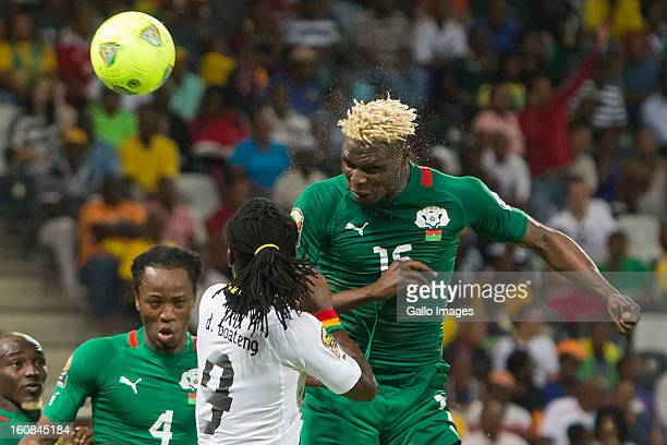 Aristide Bance from Burkina Faso heads the ball during the 2013 Orange African Cup of Nations 2nd Semi Final match between Burkina Faso and Ghana at...