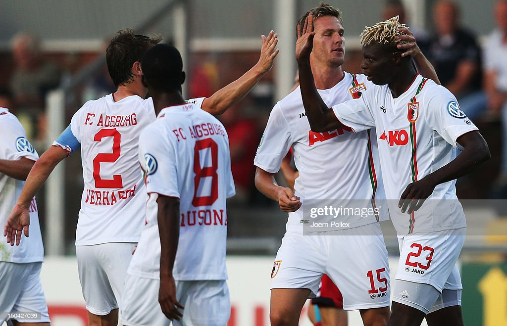 Aristide Bance (R) of Augsburg celebrates with his team mates after scoring his team's first goal during the DFB Cup first round match between SV Wilhelmshaven and FC Augsburg at Jade-Stadion on August 17, 2012 in Wilhelmshaven, Germany.