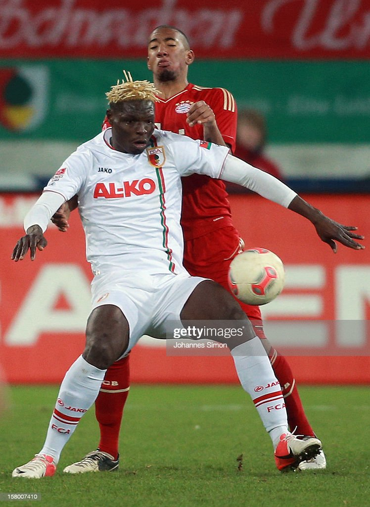 <a gi-track='captionPersonalityLinkClicked' href=/galleries/search?phrase=Aristide+Bance&family=editorial&specificpeople=3123631 ng-click='$event.stopPropagation()'>Aristide Bance</a> (L) of Augsburg fights for the ball with <a gi-track='captionPersonalityLinkClicked' href=/galleries/search?phrase=Jerome+Boateng&family=editorial&specificpeople=2192287 ng-click='$event.stopPropagation()'>Jerome Boateng</a> of Bayern during the Bundesliga match between FC Augsburg and FC Bayern Muenchen at SGL Arena on December 8, 2012 in Augsburg, Germany.
