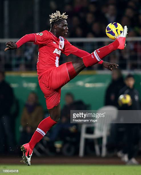 Aristide Bance of Augsburg runs with the ball during the DFB Cup second round match between Preussen Muenster and FC Augsburg at Preussenstadion on...