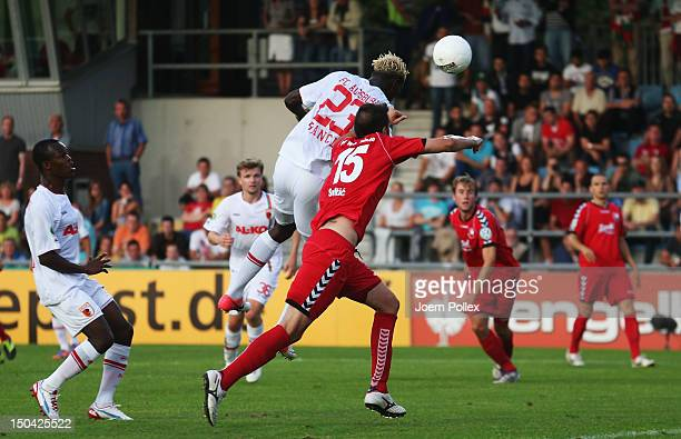 Aristide Bance of Augsburg scores his team's first goal during the DFB Cup first round match between SV Wilhelmshaven and FC Augsburg at JadeStadion...
