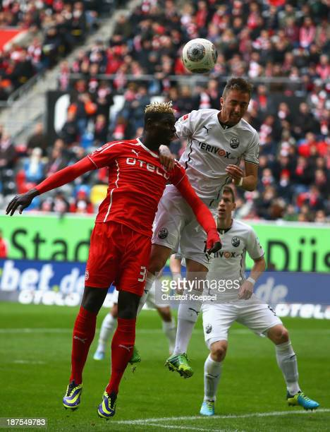 Aristide Bance of Duesseldorf and Florian Huebner of Sandhausen go up for a header during the Second Bundesliga match between Fortuna Duesseldorf and...