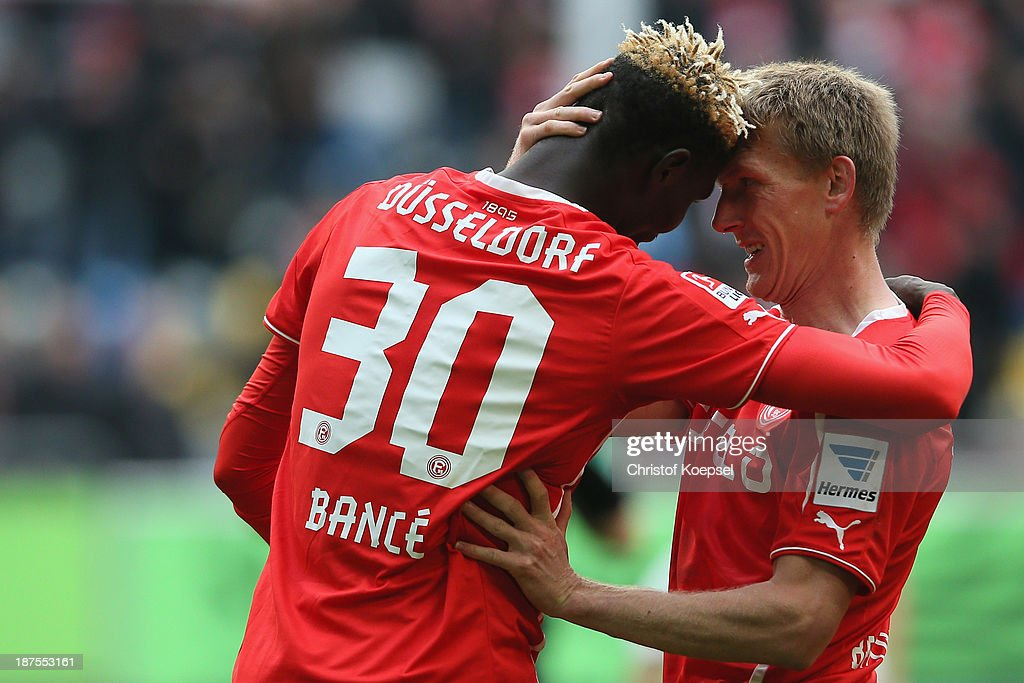 Aristide Bance of Duesseldorf celebrates the first goal with <a gi-track='captionPersonalityLinkClicked' href=/galleries/search?phrase=Axel+Bellinghausen&family=editorial&specificpeople=634917 ng-click='$event.stopPropagation()'>Axel Bellinghausen</a> of Duesseldorf during the Second Bundesliga match between Fortuna Duesseldorf and SV Sandhausen at Esprit-Arena on November 10, 2013 in Duesseldorf, Germany.