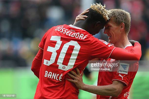 Aristide Bance of Duesseldorf celebrates the first goal with Axel Bellinghausen of Duesseldorf during the Second Bundesliga match between Fortuna...