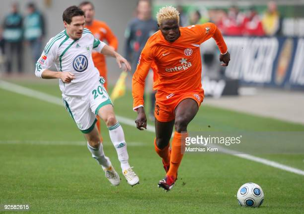Aristide Bance of Mainz battles for the ball with Sascha Riether of Wolfsburg during the Bundesliga match between VFL Wolfsburg and FSV Mainz 05 at...