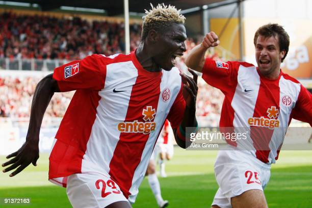 Aristide Bance of Mainz celebrates his team's second goal with team mate Andreas Ivanschitz during the Bundesliga match between FSV Mainz 05 and 1899...