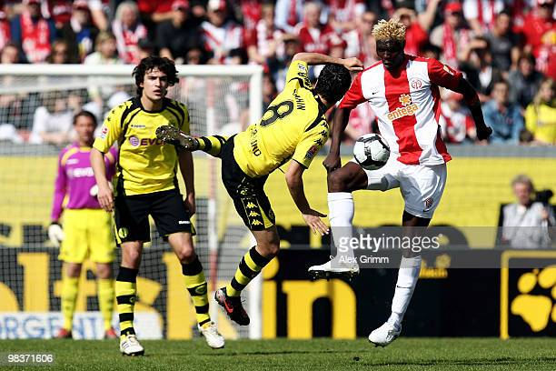 Aristide Bance of Mainz is challenged by Nuri Sahin and Mats Hummels of Dortmund during the Bundesliga match between FSV Mainz 05 and Borussia...