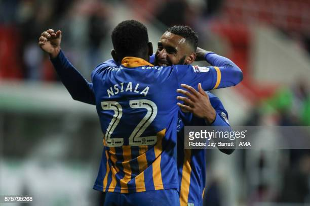 Aristote Nsiala of Shrewsbury Town and Stefan Payne of Shrewsbury Town celebrate at full time during the Sky Bet League One match between Rotherham...