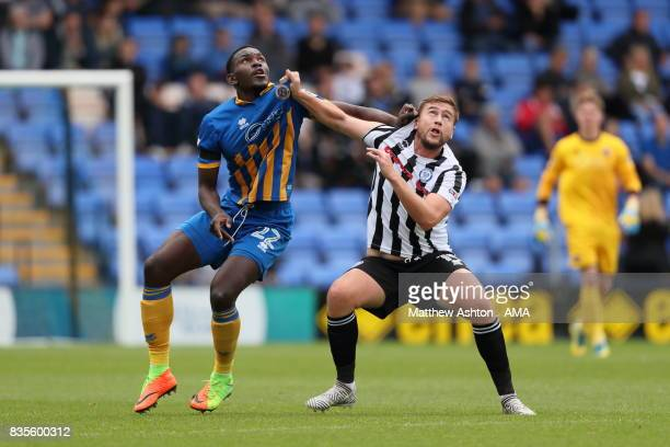 Aristote Nsiala of Shrewsbury Town and Steven Davies of Rochdale during the Sky Bet League One match between Shrewsbury Town and Rochdale at New...