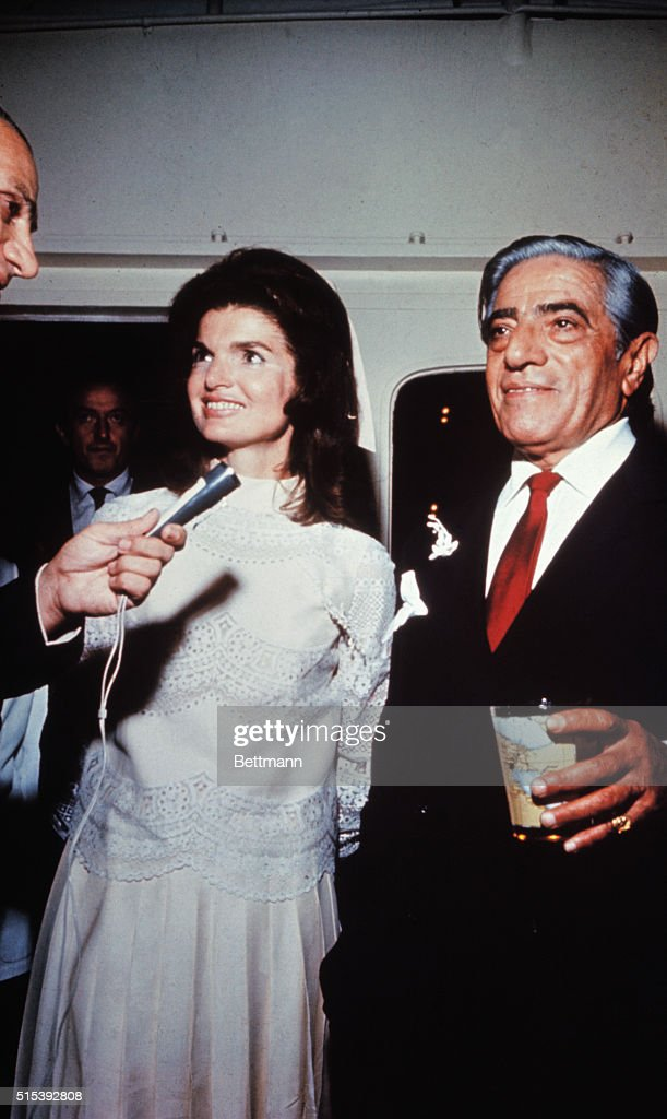 <a gi-track='captionPersonalityLinkClicked' href=/galleries/search?phrase=Aristotle+Onassis&family=editorial&specificpeople=217821 ng-click='$event.stopPropagation()'>Aristotle Onassis</a> married Jackie Kennedy on his private island. Onassis is shown with a drink in his hand and Jackie is smiling and talking into a microphone and wearing her white wedding dress.