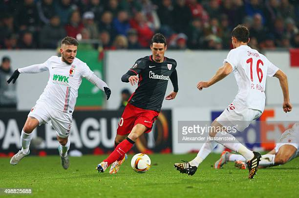 Aritz Aduriz of Athletic Bilbao takes on Kostas Stafylidis and Christoph Janker of Augsburg during the UEFA Europa League Group L match between FC...
