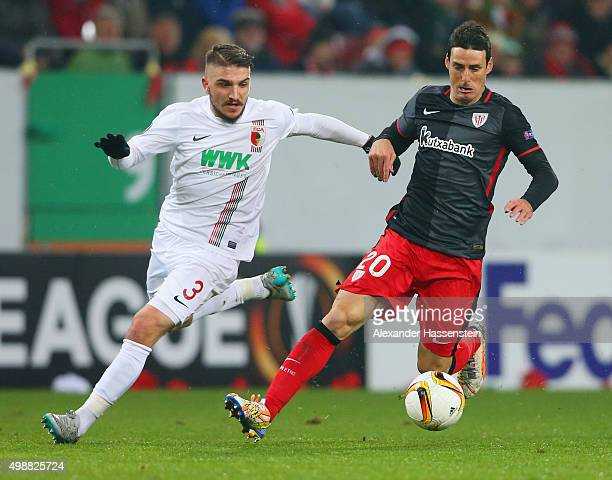 Aritz Aduriz of Athletic Bilbao takes on Kostas Stafylidis of Augsburg during the UEFA Europa League Group L match between FC Augsburg and Athletic...