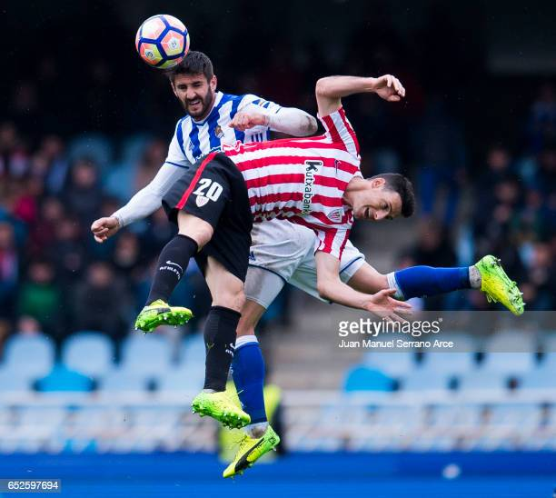 Aritz Aduriz of Athletic Club Bilbao duels for the ball with Raul Rodriguez Navas of Real Sociedad during the La Liga match between Real Sociedad de...