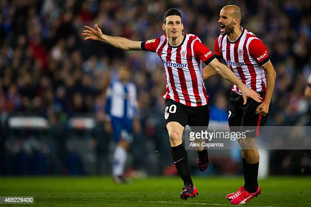 Aritz Aduriz of Athletic Club celebrates with his teammate Mikel Rico after scoring the opening goal during the Copa del Rey SemiFinal Second Leg...