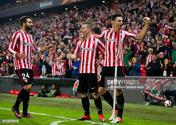 Aritz Aduriz of Athletic Club celebrates with his teammates Iker Muniain of Athletic Club after scoring his team's fourth goal during the UEFA Europa...