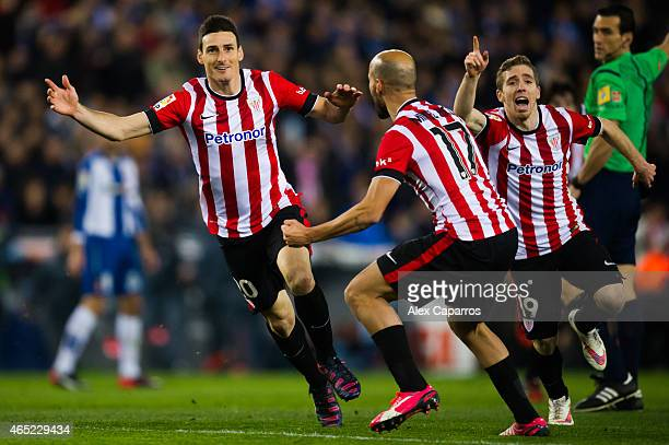 Aritz Aduriz of Athletic Club celebrates with his teammates Mikel Rico and Iker Muniain after scoring the opening goal during the Copa del Rey...