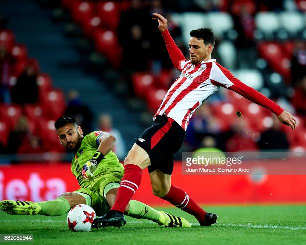 Aritz Aduriz of Athletic Club duels for the ball with Agustin Marcos Contreras of SD Formentera during the Copa del Rey Round of 32 Second Leg match...