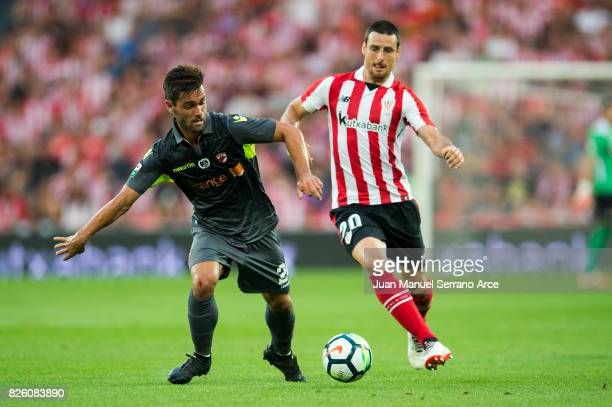 Aritz Aduriz of Athletic Club duels for the ball with Filipe Nascimento of Dinamo Bucarest during the UEFA Europa League Third Qualifying Round...