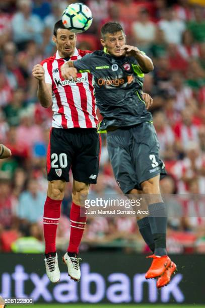 Aritz Aduriz of Athletic Club duels for the ball with Giorgos Katsikas of Dinamo Bucarest during the UEFA Europa League Third Qualifying Round Second...