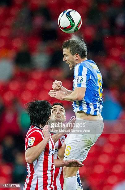 Aritz Aduriz of Athletic Club duels for the ball with Ignacio Camacho of Malaga CF during the Copa del Rey Quarter Final Second Leg match between...