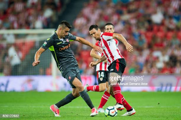 Aritz Aduriz of Athletic Club duels for the ball with Ionut Nedelcearu of Dinamo Bucarest during the UEFA Europa League Third Qualifying Round Second...