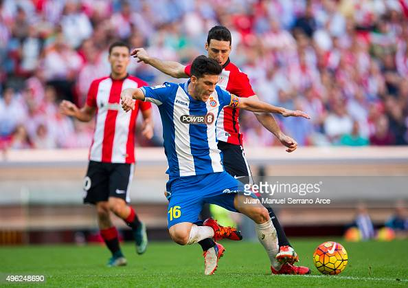 Aritz Aduriz of Athletic Club duels for the ball with Javier Lopez of RCD Espanyol during the La Liga match between Athletic Club and RCD Espanyol at...