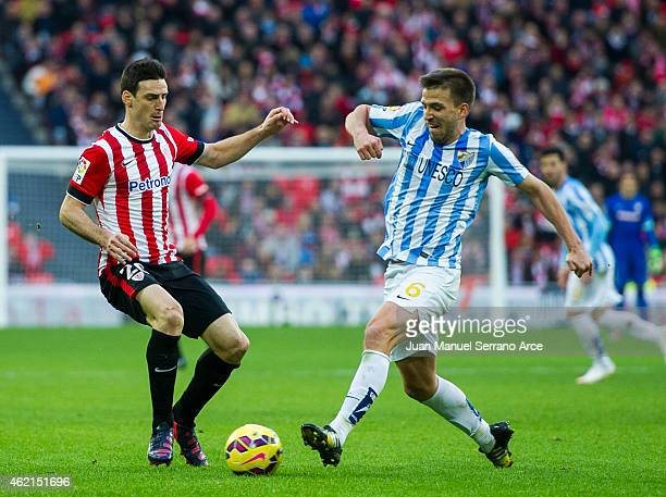 Aritz Aduriz of Athletic Club duels for the ball withÊIgnacio Camacho of Malaga CF during the La Liga match between Athletic Club and Malaga CF at...