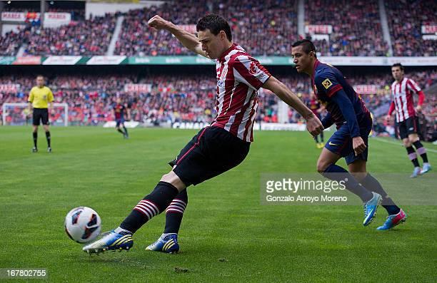 Aritz Aduriz of FC Barcelona strikes the ball during the La Liga match between Athletic Club de Bilbaoand FC Barcelona at San Mames Stadium on April...