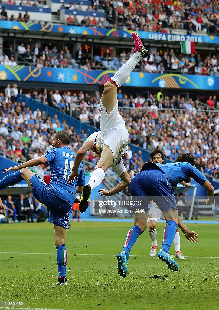 <a gi-track='captionPersonalityLinkClicked' href=/galleries/search?phrase=Aritz+Aduriz&family=editorial&specificpeople=822012 ng-click='$event.stopPropagation()'>Aritz Aduriz</a> of Spain goes airborne after a collision during the UEFA Euro 2016 Round of 16 match between Italy and Spain at Stade de France on June 27, 2016 in Paris, France.