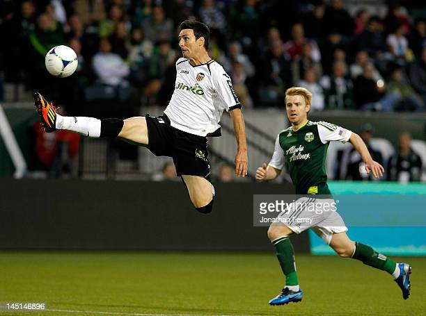 Aritz Aduriz of Valencia leaps for the ball against the Portland Timbers at JeldWen Field on May 23 2012 in Portland Oregon