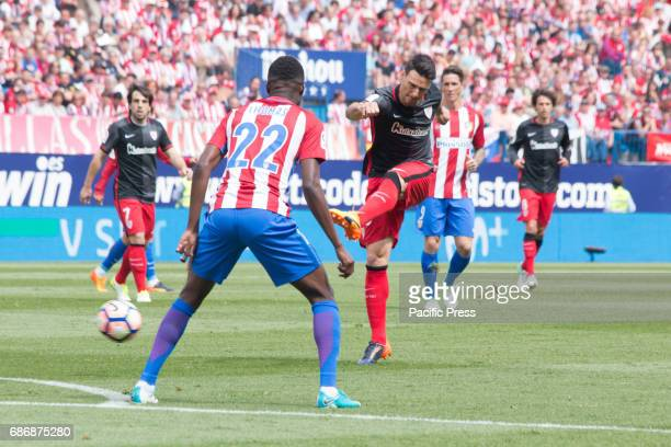 Aritz Aduriz shoot to goal meanwhile Thomas Partey of Atetico Madrid try to defend Atletico de Madrid wins by 3 to 1 over Athletic de Bilbao