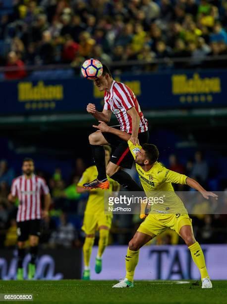 Aritz Aduriz Zubeldia of Athletic Club de Bilbao heads the ball next to Musacchio of Villarreal CF during the La Liga match between Villarreal CF and...