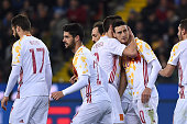 Aritz Aduriz Zubeldia of Spain celebrates a goal with team mates during the international friendly match between Italy and Spain at Stadio Friuli on...