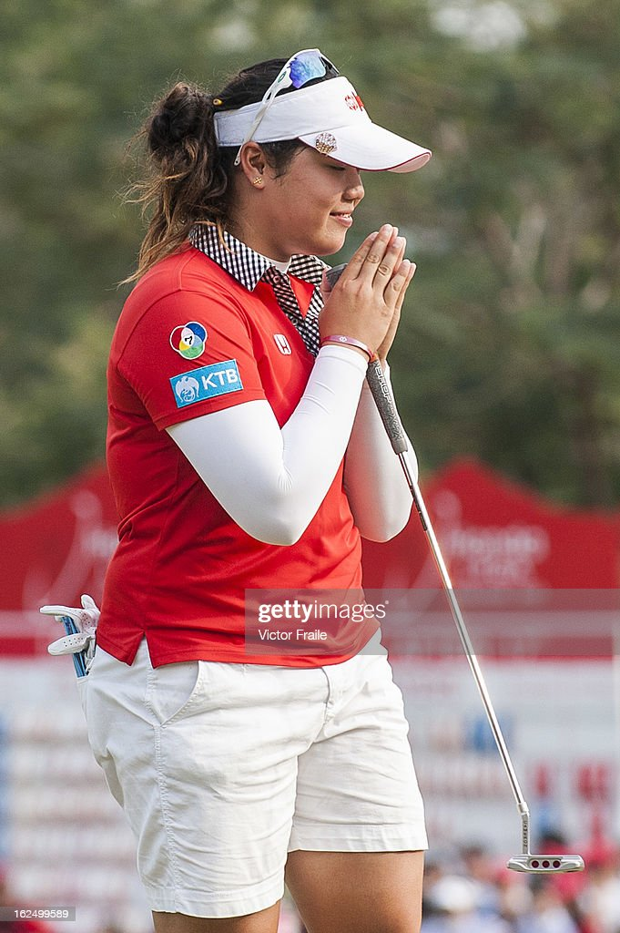Ariya Jutanugarn of Thailand acknowledges to the crowd after a triple bogey on the 18th green during day four of the Hond LPGA Thailand at Siam Country Club on February 24, 2013 in Chon Buri, Thailand. Inbee Park of South Korea won the event.