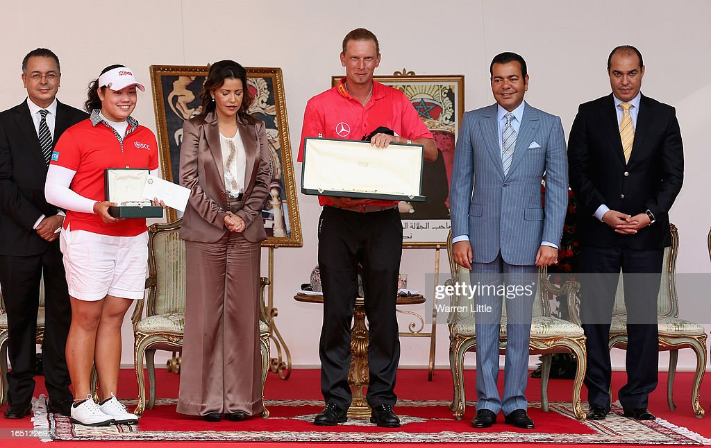 Ariya Jutanugarn of Thailand and Marcel Siem of Germany are awarded their trophies by HRH Prince Moulay Rachid afterthe Trophee du Hassan II Golf on a score of -17 under par at Golf du Palais Royal on March 31, 2013 in Agadir, Morocco.