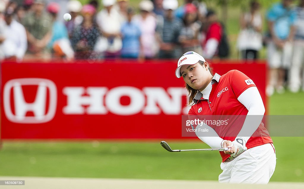 Ariya Jutanugarn of Thailand chips into the 14th green during day four of the Hond LPGA Thailand at Siam Country Club on February 24, 2013 in Chon Buri, Thailand.