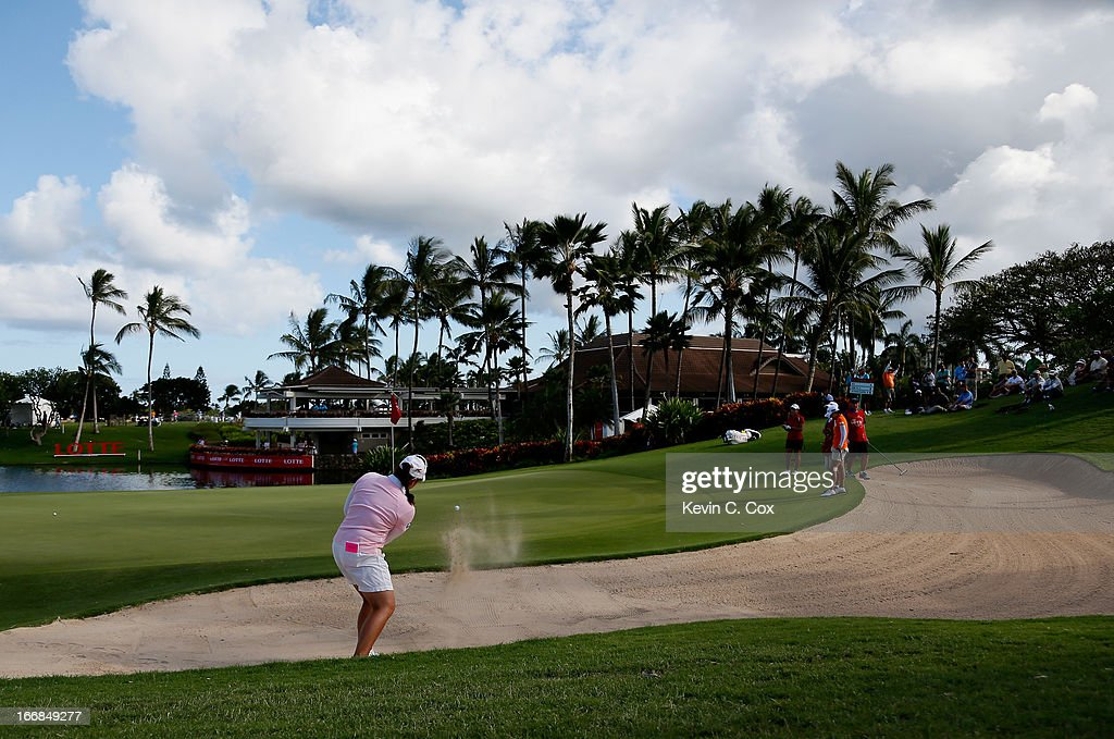 Ariya Jutanugarn of Thailand hits out of the sand on the 18th hole during the first round of the LPGA LOTTE Championship Presented by J Golf at the Ko Olina Golf Club on April 17, 2013 in Kapolei, Hawaii.