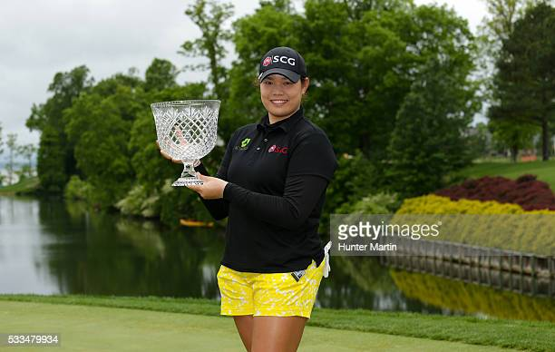 Ariya Jutanugarn of Thailand holds the championship trophy after winning the Kingsmill Championship presented by JTBC on the River Course at...