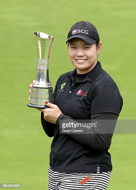 Ariya Jutanugarn of Thailand holds the trophy after her three shot victory during the final round of the 2016 Ricoh Women's British Open on the...