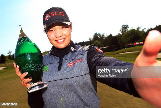 Ariya Jutanugarn of Thailand imitates a 'selfie' after sinking her birdie putt on the 1st playoff hole to win during the final round of the Manulife...