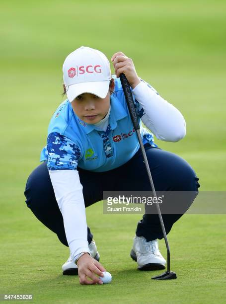 Ariya Jutanugarn of Thailand lines up a putt during the weather delayed first round of The Evina Championship at Evian Resort Golf Club on September...