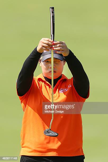 MELBOURNE AUSTRALIA FEBRUARY Ariya Jutanugarn of Thailand lines up a putt on the the green during day one of the LPGA Australian Open at Royal...