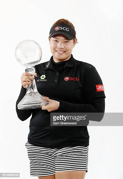 Ariya Jutanugarn of Thailand poses with the CME Race for the Globe trophy during the final round of the CME Group Tour Championship at Tiburon Golf...